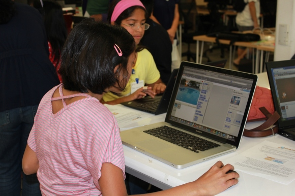 Students learning Scratch